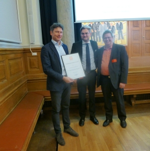 Årets prisvinder formanden for PLO Christian Freitag, justitsminister Søren Pind samt formanden for prisjuryen, Ian Erdmann